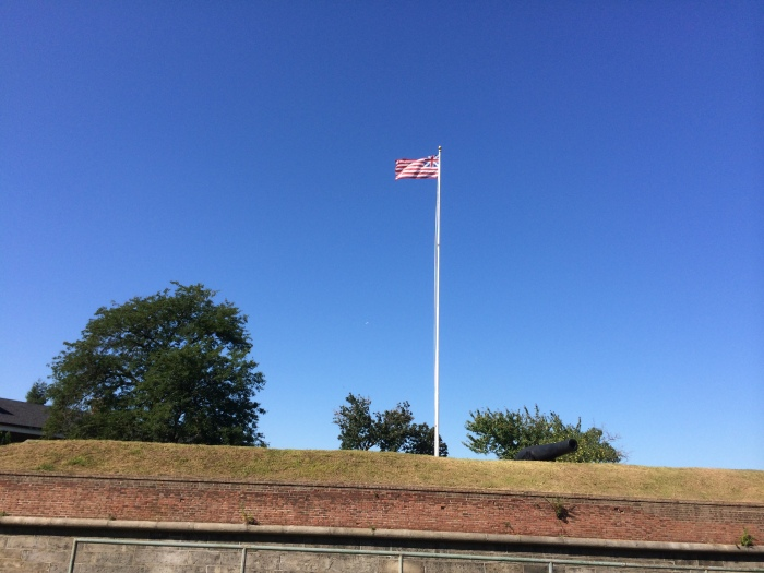 The Colonial Era Grand Union flying over Fort Jay today.  Look closely at the canton and you will see the Union Jack.