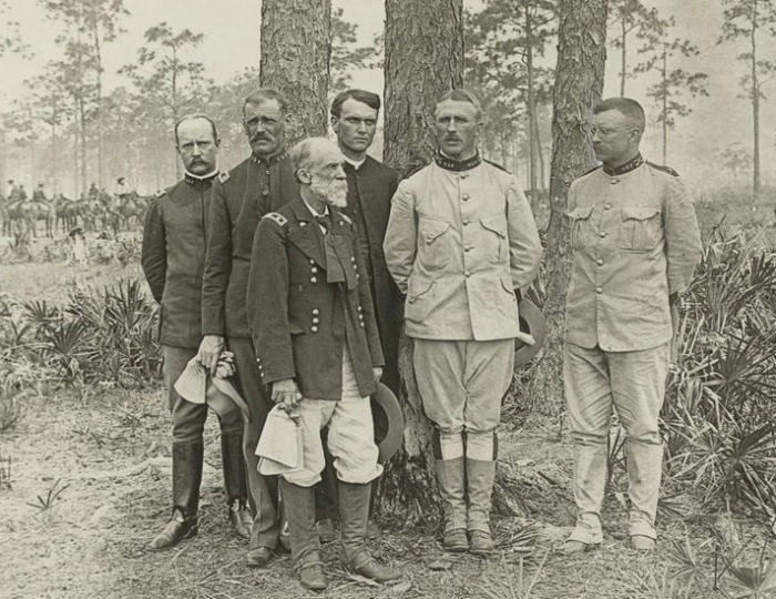The Rough Riders: General Joseph Wheeler (front), Leonard Wood (second from right), and Theodore Roosevelt Roosevelt (far right). Three years after this photo was taken the former Confederate general would help dedicate the Governors Island Y.M.C.A.