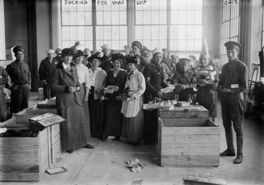 Workers and volunteers pack the last of toys donated to the children of Europe rendered homeless in the early months of the Great War, 14 November 1914