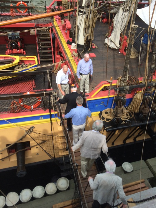 An aging WW2 veterans is escorted onto the Hermione, July 3, 2015