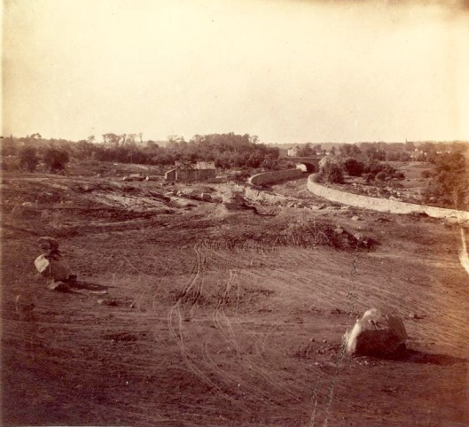This 1862 photograph shows the construction of Central Park. Note how the soil has been raked and the boulders placed in preparation for the landscaping that would come later.