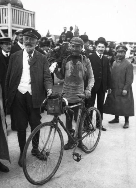 July 31, 1910: an exhausted Lapize wins the Tour de France. Note the flowers.