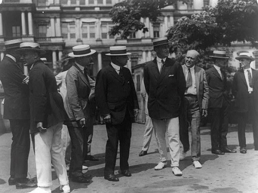 Roosevelt (in white pants at center right) and James M. Cox arrive at the White House with reporters in tow prior to their meeting with President Wilson, July 1920. Cox, with FDR as his running mate, lost his presidential bid that year. Roosevelt was assistant secretary of the navy at the time.