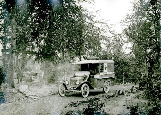 The original Ambulance 255 attending the wounded  in the Woevre, September 1916. Note the bell on the left, which was used to warn of gas attacks.