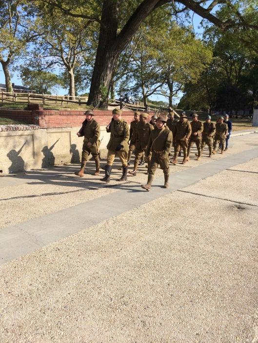 Living doughboy historians march through the historic district for the closing ceremony.