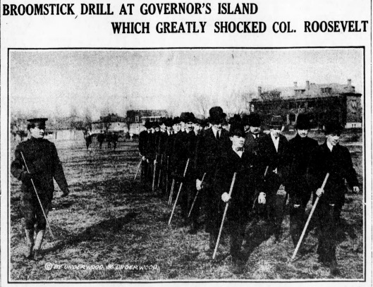 Civilian Plattsburgh participants march on Governors Island with broomsticks, February 1917. It is not clear from the original Brooklyn Daily Eagle caption if this image was taken the day Colonel Roosevelt turned out at Governors Island on 17 February 1917 to meet Leonard Wood and give his support to the men.